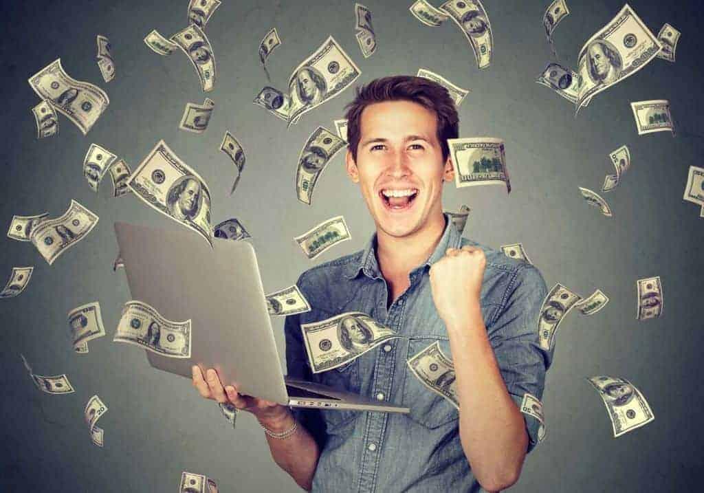 Man standing in raining dollar bills - The WordPress WordAds program
